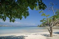 Areia branca tropical beach view near dili in east timor. Areia branca tropical beach view and coast near dili in east timor stock photo