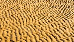 Areia com marcas da onda Imagem de Stock Royalty Free