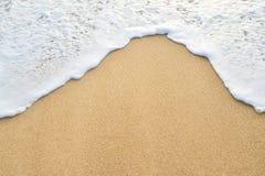 Areia da onda Imagens de Stock