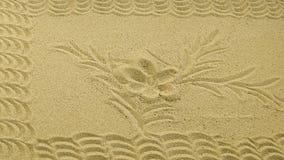 Areia de um castiçal com um ornamento fotos de stock royalty free