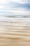 Areia e água no movimento Fotografia de Stock Royalty Free