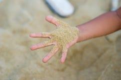 Areia e dedo Imagem de Stock Royalty Free