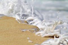 Areia e espuma foto de stock