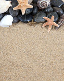 Areia e estrela do mar imagem de stock royalty free
