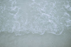 Areia e mar Imagens de Stock Royalty Free