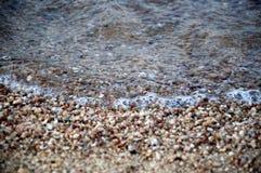 Areia e mar do close up Foto de Stock Royalty Free