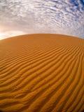 Areia e nuvens Fotografia de Stock