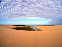 Areia e nuvens Imagem de Stock