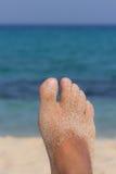 Areia e pé Imagens de Stock