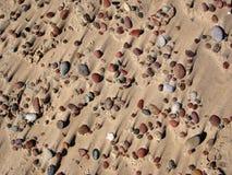 Areia e pedras. Fotos de Stock