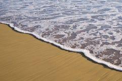 Areia e ressaca Foto de Stock