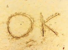 Areia molhada de OKon do texto Imagens de Stock Royalty Free