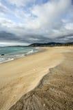 Areia molhada na praia Imagem de Stock Royalty Free