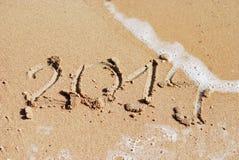 Areia número 2014 na praia Foto de Stock
