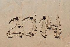 Areia número 2014 na praia Imagens de Stock