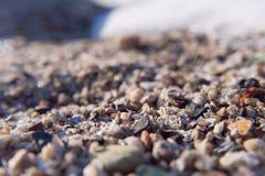 A areia na praia do mar Imagens de Stock