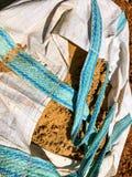 Areia no saco no canteiro de obras, materiais de construção fotografia de stock royalty free