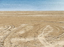 A areia que olha para fora ao mar Imagem de Stock Royalty Free