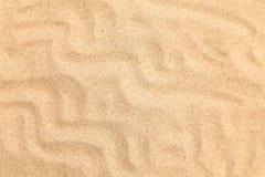 Areia sem emenda em um fundo inteiro. Textura. Foto de Stock Royalty Free