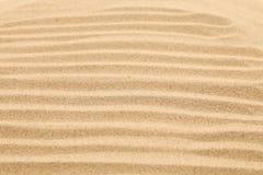 Areia sem emenda em um fundo inteiro. Textura. Fotos de Stock