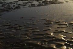 Arena de la ondulación del mar Fotografía de archivo libre de regalías