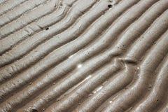 Arena de la ondulación en la playa Fotos de archivo libres de regalías
