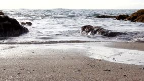 Arena de la playa del océano de la onda de agua almacen de metraje de vídeo