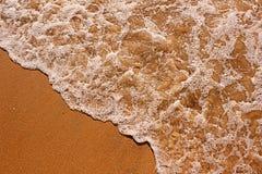 Arena de la playa en la costa Imágenes de archivo libres de regalías