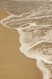 Arena de mar y onda Imagen de archivo libre de regalías