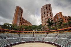 Arena de toros with appartment skyscrapers Royalty Free Stock Photo