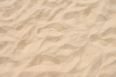 Arena fina de la playa en el sol del verano Imagen de archivo libre de regalías
