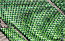 Arena with green empty tribune without people Royalty Free Stock Image