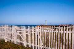Arena Lighthouse behind old fence Royalty Free Stock Photos