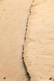 arena mojada por el mar Imagen de archivo libre de regalías