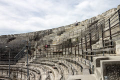 Arena of Nimes France. The arena of Nimes ancient roman ruins now used for bullfighting and as a stage for shows. Nimes, Provence, France Stock Photo