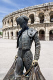 Arena of Nimes France. A bullfighter statue in front of the arena of Nimes, France Stock Photo