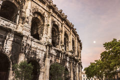 Arena of Nimes at sunrise and moonset Royalty Free Stock Photos