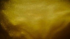 Arena o polvo de oro que crea formaciones abstractas de la nube Fondos del arte almacen de metraje de vídeo