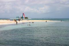 Arena, playa y catamarán Fotografía de archivo libre de regalías
