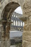 The Arena in Pula. Inside of The Arena in Pula framed by a Arch Royalty Free Stock Photo