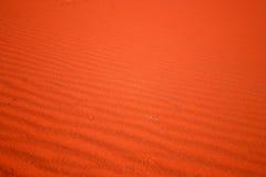 Arena roja Foto de archivo