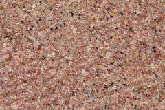 Arena rosada de la playa Imagen de archivo libre de regalías