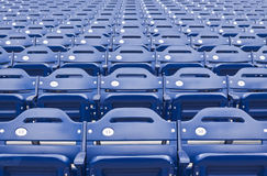 Arena Seating. Rows of empty blue numbered stadium or arena seating royalty free stock photos