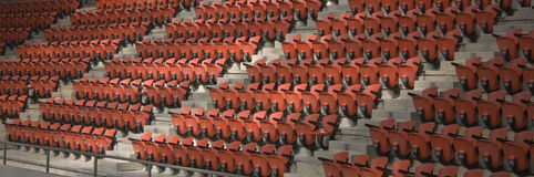 Arena Seats. A section of empty orange seats in an arena Stock Images