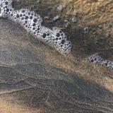 Arena y agua Imagen de archivo libre de regalías