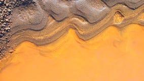 Arena y agua amarilla Textura abstracta Colores de la naturaleza Cierre para arriba fotografía de archivo