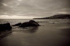 Arena y resaca de Laguna Imagenes de archivo
