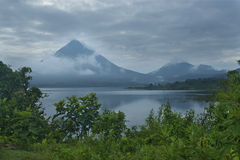 Arenal Reflection. A picture of the lively Arenal volcano and Lake Arenal Royalty Free Stock Images