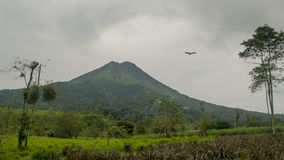 Arenal Volcano. Clearing up for a good view of the crater Royalty Free Stock Image