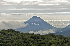 Arenal Volcano between Clouds Stock Photo